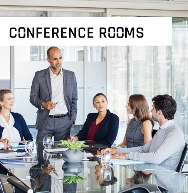 Conference Room with Men standing and speaking