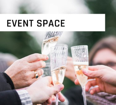 Event Space with Glasses Clinking with Champagne