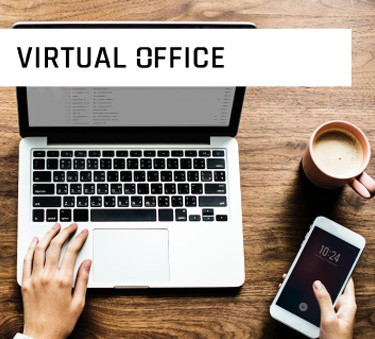 virtual Office with woman working on laptop with coffee and her phone