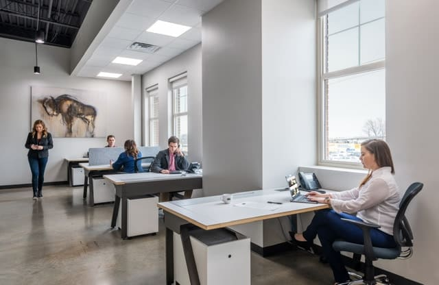 Example of open Coworking stations with people working